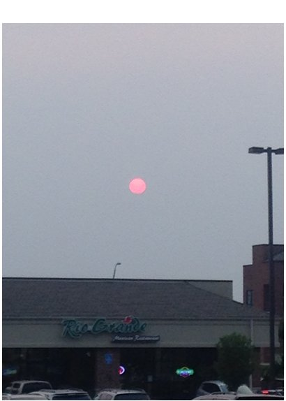 Sun obscured by wildfire smoke from Alberta, Canada. Columbia, MO, 8:04 p.m. CDT, June 28, 2015. Photo: Pat Guinan